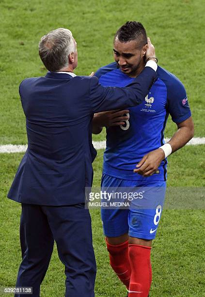 France's forward Dimitri Payet is congratulated by France's coach Didier Deschamps after scoring the 2-1 goal during the Euro 2016 group A football...