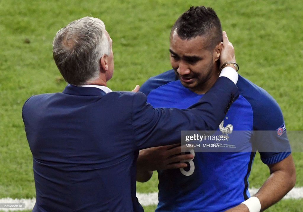 France's forward Dimitri Payet (R) is congratulated by France's coach Didier Deschamps after scoring the 2-1 goal during the Euro 2016 group A football match between France and Romania at Stade de France, in Saint-Denis, north of Paris, on June 10, 2016. France won the match 2-1. /