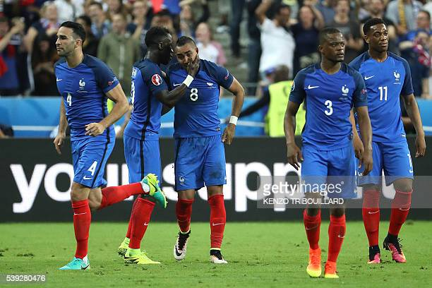 France's forward Dimitri Payet is congratulated by France's defender Bacary Sagna after scoring the second goal for France during the Euro 2016 group...