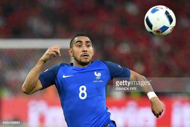 France's forward Dimitri Payet plays for the ball during the Euro 2016 group A football match between France and Albania at the Velodrome stadium in...