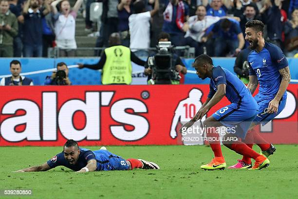 France's forward Dimitri Payet scores France's second goal during the Euro 2016 group A football match between France and Romania at Stade de France,...