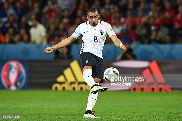 France's forward Dimitri Payet shoots the ball during the Euro 2016 group A football match between Switzerland and France at the PierreMauroy stadium...