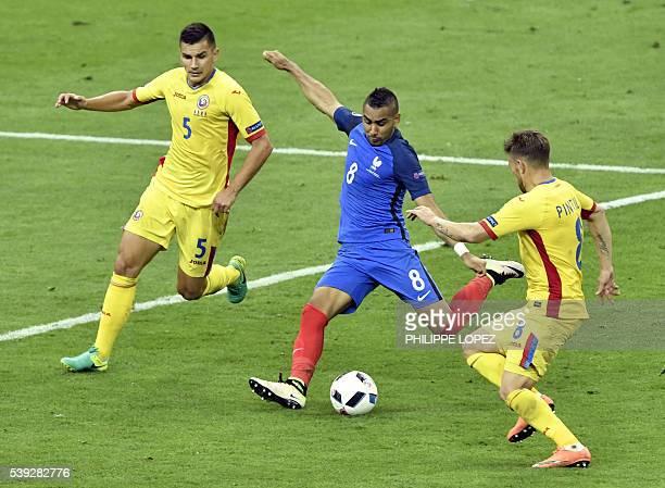 France's forward Dimitri Payet shoots to score past Romania's midfielder Ovidiu Hoban and Romania's midfielder Mihai Pintilii during the Euro 2016...