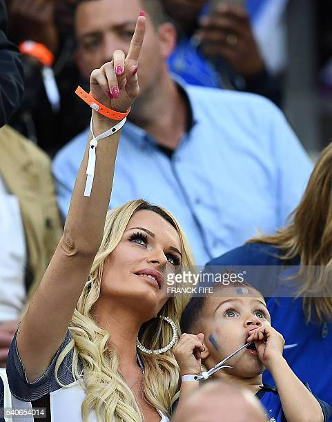 France's forward Dimitri Payet's wife Ludivine Payet gestures during the start of the Euro 2016 group A football match between France and Albania at...