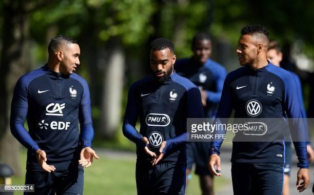 France's forward Dumitri Payet France's forward Alexandre Lacazette and France's midfielder Corentin Tolisso speak together during a training session...