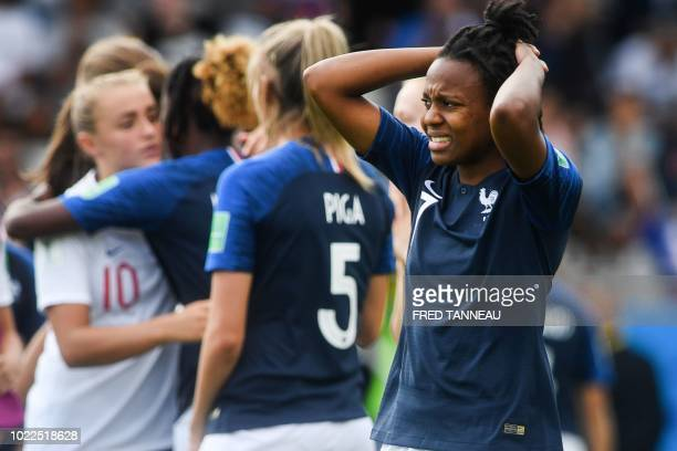 France's forward Emelyne Laurent reacts at the end of the Women's U20 World Cup 3rd place football match between France and England at the La Rabine...
