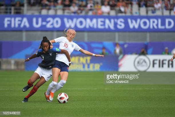 France's forward Emelyne Laurent vies with England's forward Chloe Kelly during the Women's U20 World Cup play-off for third place football match...