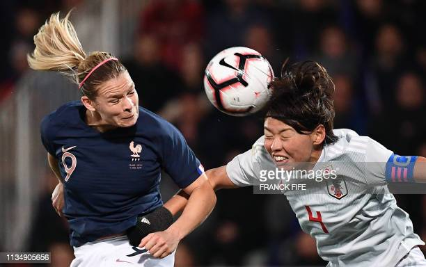 France's forward Eugenie Le Sommer and Japan's defender Saki Kumagai during the FIFA international friendly football match between France and Japan...