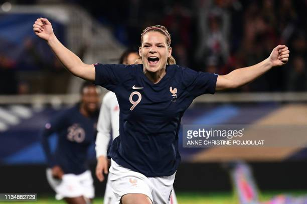 France's forward Eugenie Le Sommer celebrates after scoring a goal during the FIFA international friendly football match between France and Japan at...
