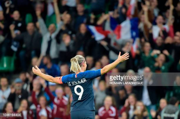 France's forward Eugenie Le Sommer celebrates after scoring during the women's friendly football match between France and Australia on October 5 at...