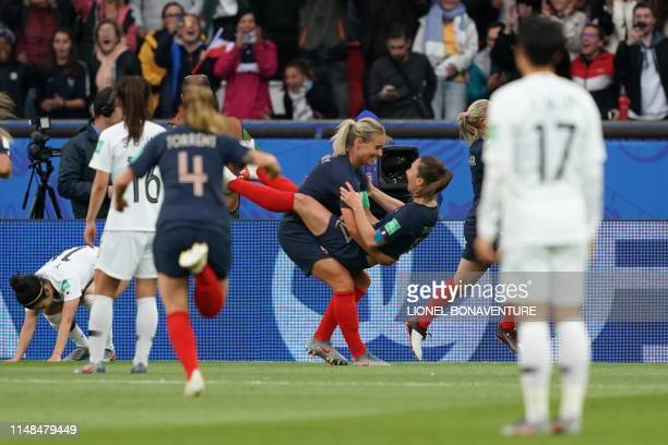 TOPSHOT France's forward Eugenie Le Sommer celebrates with teammates after scoring a goal during the France 2019 Women's World Cup Group A football...
