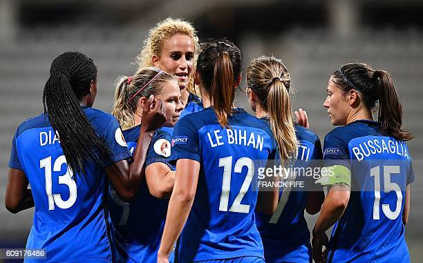 France's forward Eugenie Le Sommer is congratuled after scoring a goal during the Women Euro 2017 qualifying football match France vs Albania at the...