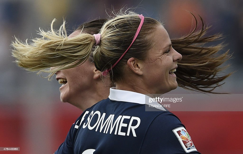 France's forward Eugenie Le Sommer (R) is congratuled by France's forward Gaetane Thiney after scoring a goal during a Group F match at the 2015 FIFA Women's World Cup between France and England at Moncton Stadium on June 9, 2015