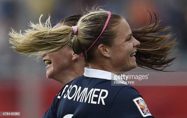 France's forward Eugenie Le Sommer is congratuled by France's forward Gaetane Thiney after scoring a goal during a Group F match at the 2015 FIFA...