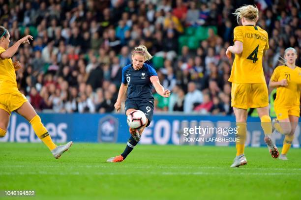 France's forward Eugenie Le Sommer kicks the ball and scores during the women's friendly football match between France and Australia on October 5 at...