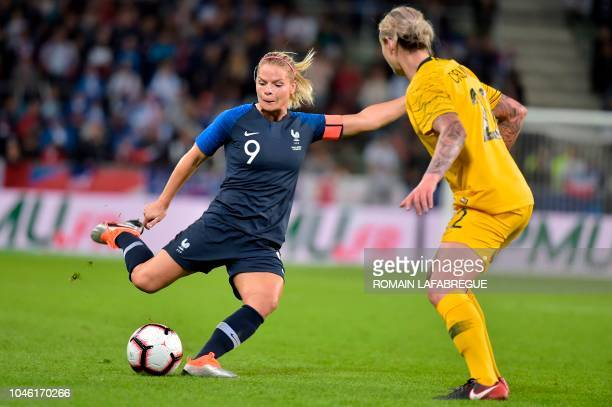 France's forward Eugenie Le Sommer kicks the ball during the women's friendly football match between France and Australia on October 5 at the...
