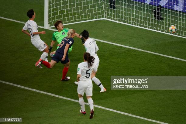 TOPSHOT France's forward Eugenie Le Sommer scores her team's first goal during the France 2019 Women's World Cup Group A football match between...