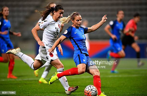 France's forward Eugenie Le Sommer shoots and scores a goal during the Women Euro 2017 qualifying football match France vs Albania at the Charlety...