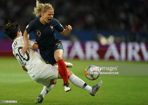 TOPSHOT France's forward Eugenie Le Sommer vies with South Korea's defender HyeRi Kim during the France 2019 Women's World Cup Group A football match...