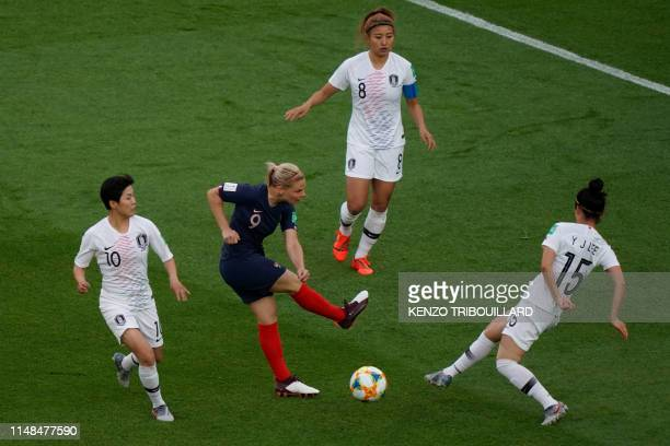 TOPSHOT France's forward Eugenie Le Sommer vies with South Korea's midfielder YoungJu Lee during the France 2019 Women's World Cup Group A football...