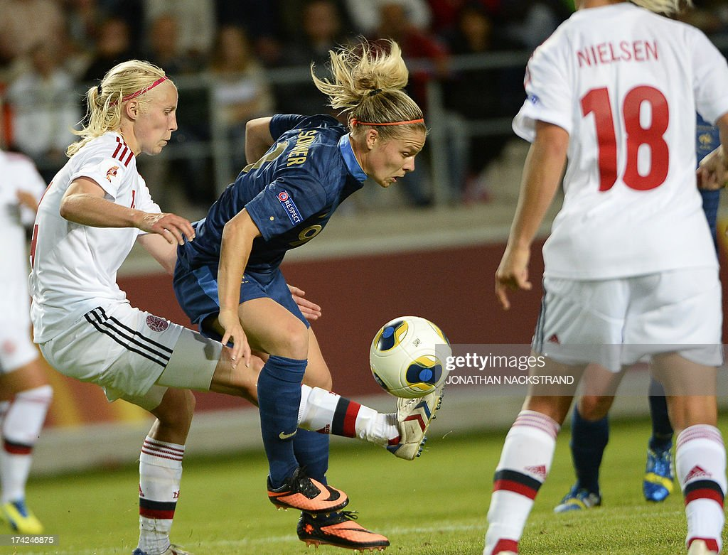 France's forward Eugnie Le Sommer (C) and Denmark's defender Christina Orntoft vie for the ball during the UEFA Women's European Championship Euro 2013 quarter final football match France vs Denmark on July 22, 2013 in Linkoping, Sweden.