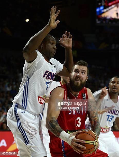 France's forward Florent Pietrus vies with Serbia's centre Miroslav Raduljica during the 2014 FIBA World basketball championships semifinal match...