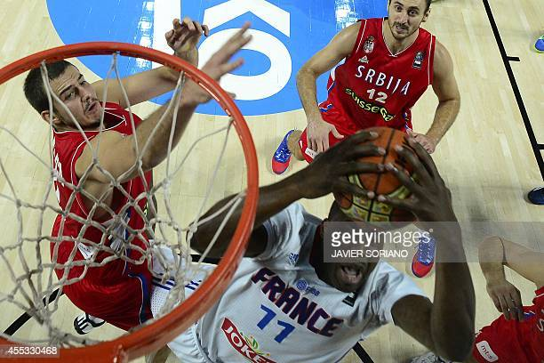 France's forward Florent Pietrus vies with Serbia's forward Nemanja Bjelica during the 2014 FIBA World basketball championships semifinal match...