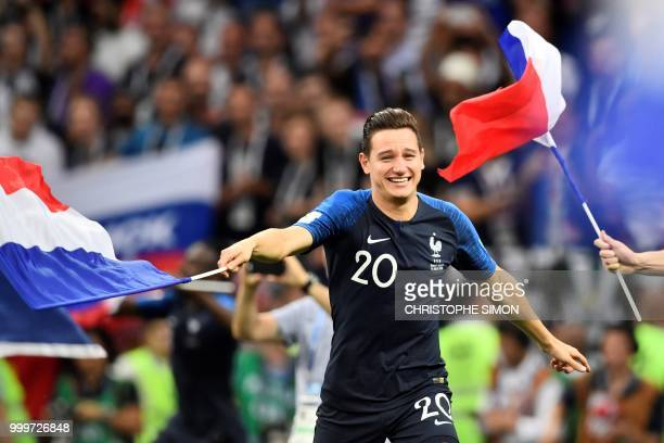 France's forward Florian Thauvin celebrates at the end of the Russia 2018 World Cup final football match between France and Croatia at the Luzhniki...