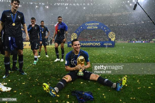 France's forward Florian Thauvin holds the World Cup trophy during the trophy ceremony at the end of the Russia 2018 World Cup final football match...