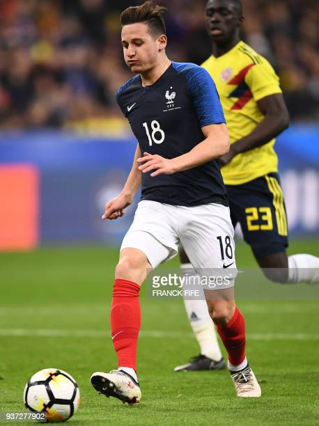 France's forward Florian Thauvin runs with the ball during the friendly football match between France and Colombia at the Stade de France in...