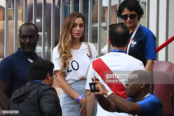 France's forward Florian Thauvin's girlfriend Charlotte Pirroni waits for the start of the Russia 2018 World Cup final football match between France...