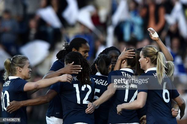 France's forward Gaetane Thiney is congratulated by teammates after scoring a goal during the friendly football match France vs Russia on May 22,...