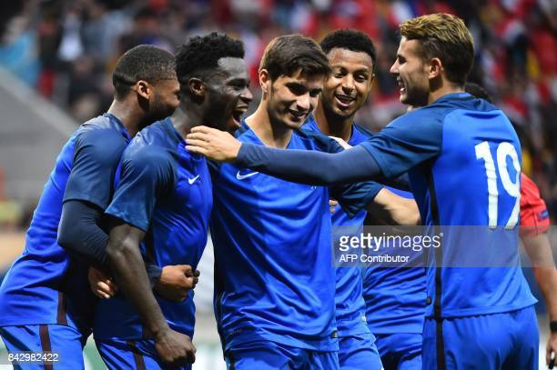 France's forward Jonathan Bamba celebrates with his teammates afer scoring during the qualifying Euro 2017 U21 football match between France and...