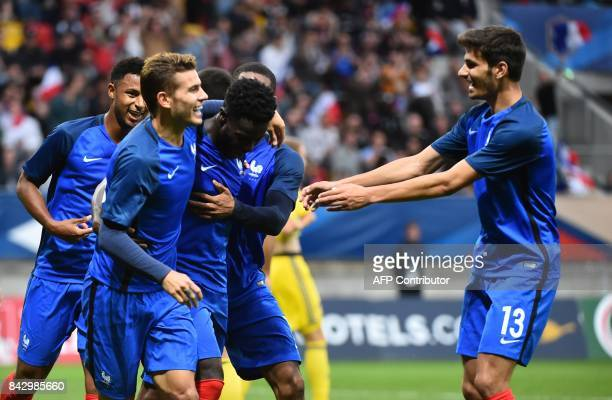 France's forward Jonathan Bamba reacts afer scoring during the qualifying Euro 2017 U21 football match between France and Kazakhstan at The MMArena...