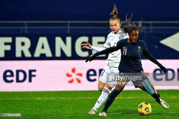 Frances forward Kadidiatou Diani fights for the ball with Kazakhstans defender Anastassiya Vlassova during the Women's UEFA Euro 2022 Group G...
