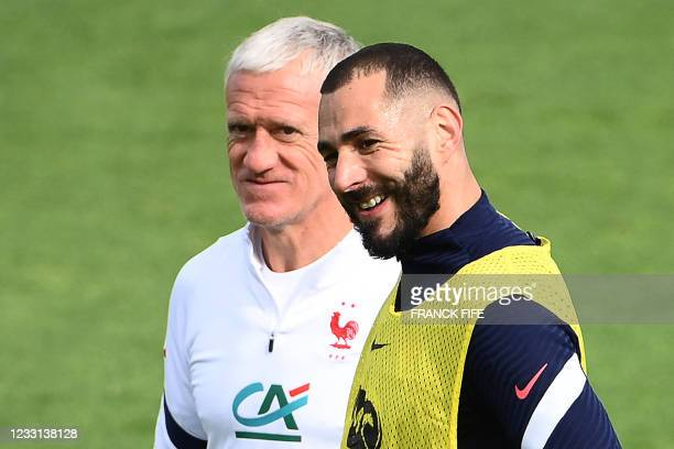 France's forward Karim Benzema and France's coach Didier Deschamps take part in a a training session in Clairefontaine-en-Yvelines on May 27 as part...