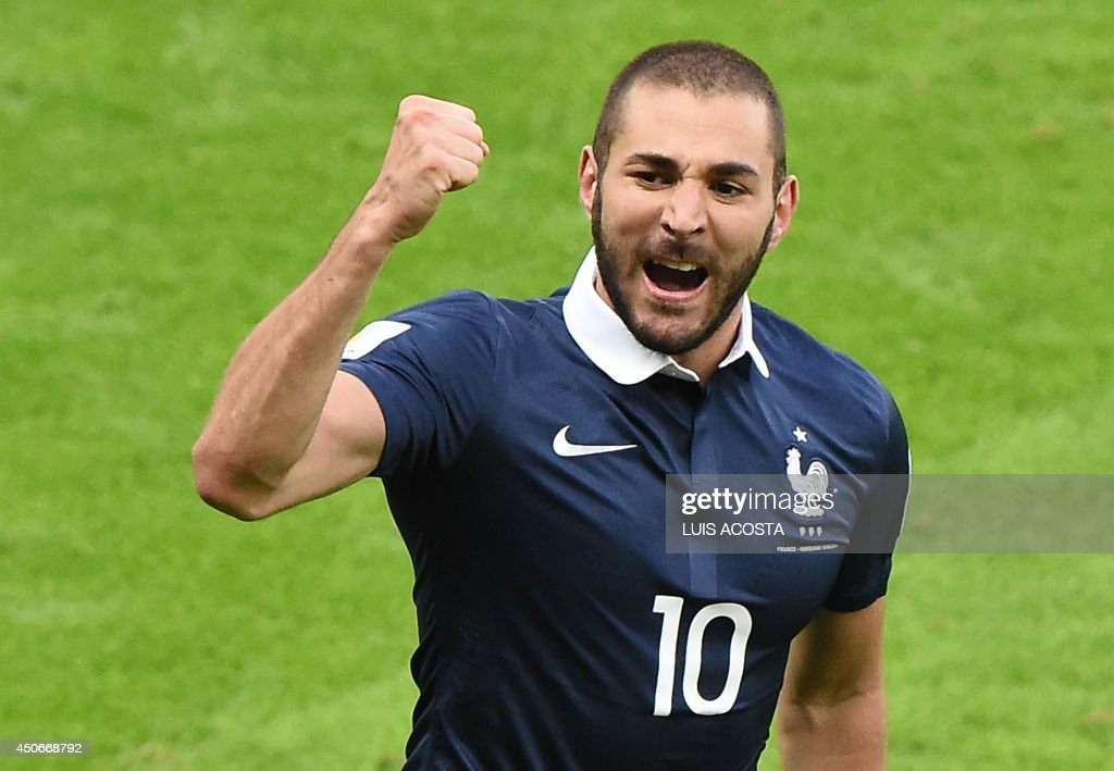 France's forward Karim Benzema celebrates after an own goal during a Group E football match between France and Honduras at the Beira-Rio Stadium in Porto Alegre during the 2014 FIFA World Cup on June 15, 2014. AFP PHOTO / LUIS ACOSTA / AFP PHOTO / Luis ACOSTA