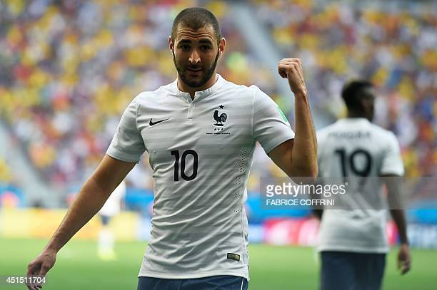 France's forward Karim Benzema celebrates after France's second goal during a Round of 16 football match between France and Nigeria at Mane Garrincha...