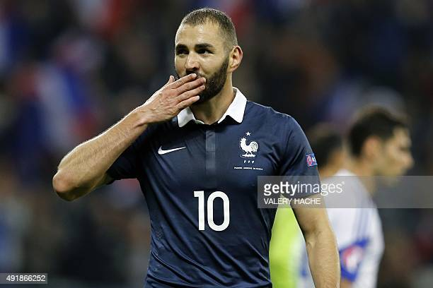 France's forward Karim Benzema celebrates after scoring a goal during the friendly football match between France and Armenia on October 8 2015 at the...