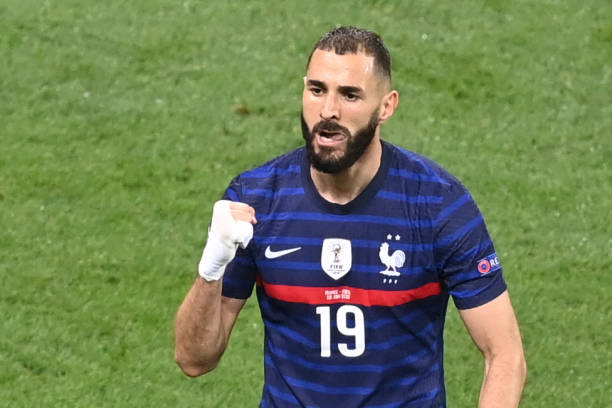 France's forward Karim Benzema celebrates scoring the team's first goal during the UEFA EURO 2020 round of 16 football match between France and...