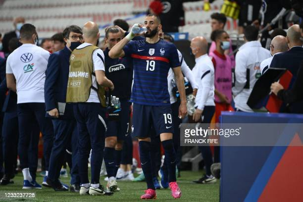 France's forward Karim Benzema drinks water after the friendly football match between France and Wales at the Allianz Riviera Stadium in Nice,...