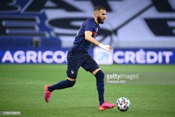 France's forward Karim Benzema drives the ball during the friendly football match between France and Wales at the Allianz Riviera Stadium in Nice,...