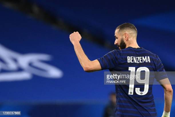 France's forward Karim Benzema gestures during the friendly football match between France and Wales at the Allianz Riviera Stadium in Nice, southern...