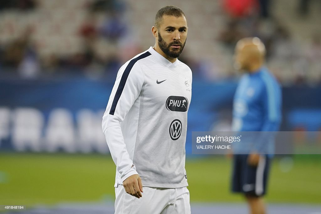 France's forward Karim Benzema looks on during a warm up prior to the friendly football match between France and Armenia on October 8, 2015 at the Allianz Riviera stadium in Nice, southeastern France.