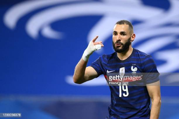 France's forward Karim Benzema reacts after a hand from a Welsh player during the friendly football match between France and Wales at the Allianz...