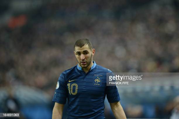 France's forward Karim Benzema reacts as he leaves the pitch during the World Cup 2014 qualifying football match France vs Spain on March 26, 2013 at...