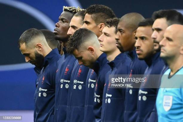 France's forward Karim Benzema reacts as they listen to a national anthem before the friendly football match between France and Wales at the Allianz...