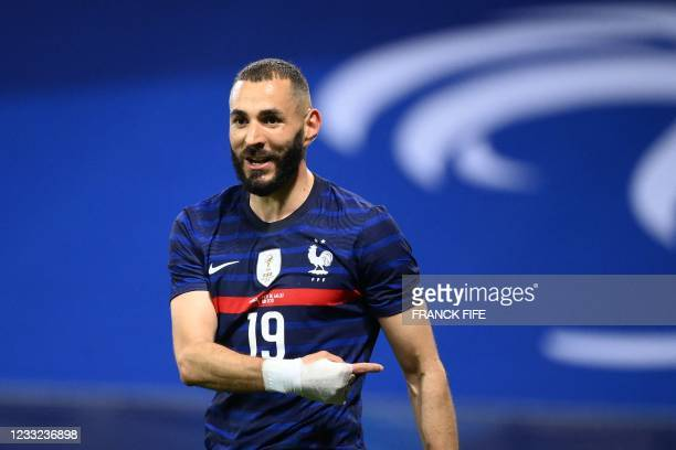 France's forward Karim Benzema reacts during the friendly football match between France and Wales at the Allianz Riviera Stadium in Nice, southern...