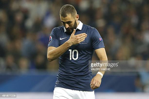 France's forward Karim Benzema reacts during the friendly football match between France and Armenia on October 8 2015 at the Allianz Riviera stadium...