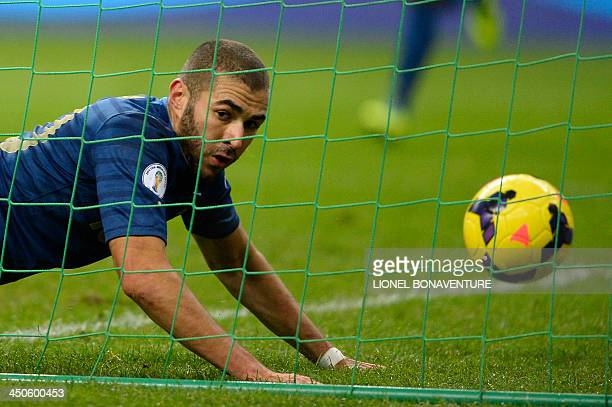 France's forward Karim Benzema scores an unvalidated goal during the FIFA World Cup 2014 qualifying football match France vs Ukraine on November 19...